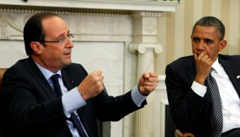 U.S. President Barack Obama looks at French President Francois Hollande as they meet in the Oval Office of the White House in Washington May 18, 2012. Hollande is in the United States to join other leaders of the major industrial economies and meet for a G8 Summit at Camp David this weekend to try to head off a full-blown financial crisis in Europe.     REUTERS/Larry Downing    (UNITED STATES - Tags: POLITICS BUSINESS)