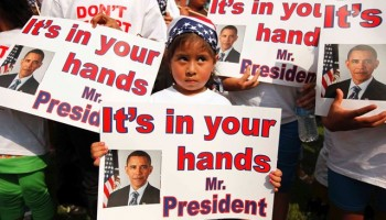 """WASHINGTON - JULY 28:  Dozens of U.S.-born children from across the country traveled to the White House with their undocumented parents to march and demonstrate against recent deportations July 28, 2010 in Washington, DC. Organized by CASA de Maryland, Familias Latinas Unidas, and other organizations, marchers describing themselves as """"Obama Orphans,"""" or children whose parents have been deported, called on President Barack Obama to keep his campaign promise of comprehensive immigration reform.  (Photo by Chip Somodevilla/Getty Images)"""