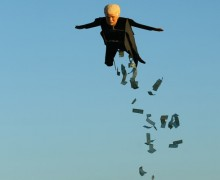 Model plane builder Otto Dieffenbach III makes his remote control plane resembling U.S. Presidential candidate Donald Trump release fake money as it flies over the beach in Carlsbad, California